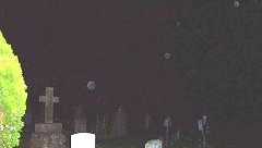 Orbs floating around Prestbury Churchyard