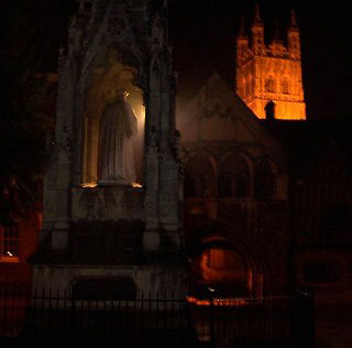 A very atmospheric picture of Bishop Hoopers monument looking towards Gloucester Cathedral